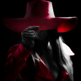 Where on Earth by Joshua Clifford - People Fashion ( cosplay, woman, long hair, hidden, selective color, glove, black, portrait, smile, red, coat, dark, hat, low key, female, costume, spotlight, fashion )