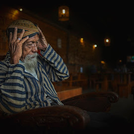 Headache by Indrawan Ekomurtomo - People Portraits of Men