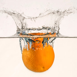 Orange splash by Dumitru Doru - Food & Drink Fruits & Vegetables ( water, orange, fruit, splash, food, white, yellow, wet )