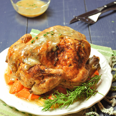 Roasted Lemon Herb Whole Chicken with Carrots and Onion