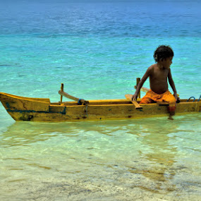 tiny boat by Bastian M - Transportation Boats (  water,  papua, beach,  child , boat )