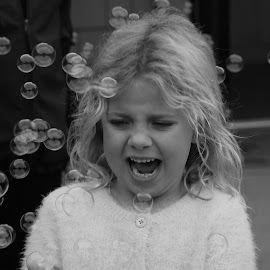 Catching bubbles by Robin Rawlings Wechsler - Babies & Children Children Candids ( child, person, girl, black and white, bubbles, people, portrait )