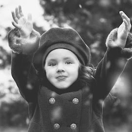 First Snow by Lindsey Sides - Babies & Children Children Candids ( playing, cold, black and white, snow, child photography, child portrait, candid, emotion, eyes )