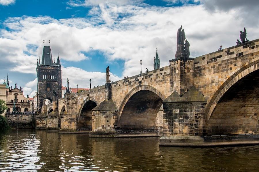 by Mario Horvat - Buildings & Architecture Bridges & Suspended Structures ( sky, visla, prague, bridge, river, clouds, water, popular, arches, tower, czech, touristic )