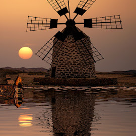 Los Molinos by Katherine Rynor - Landscapes Sunsets & Sunrises ( water, reflection, sunset, sun, windmill )