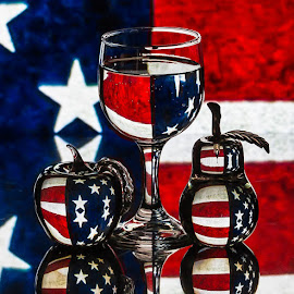 Stars And Stripes 2 by Lisa Hendrix - Artistic Objects Glass ( inversion, reflection, fruit, colors, white, reflections, object, stripes, red, blue, color, stars, apple, wine glass, artistic, glass, pear )