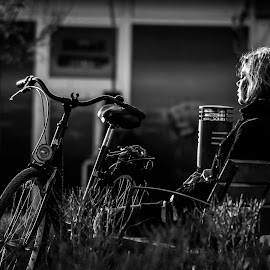Girl on bike by Tony Hampel - People Street & Candids