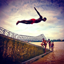 Free to fly by Anirban Chatterjee - Novices Only Portraits & People ( water, feerless, fly, enjoy, carefree )