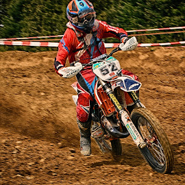 Speeding Up by Marco Bertamé - Sports & Fitness Motorsports ( fifty-two, red, motocross, dust, 52, clumps, number, race, alone, competition )