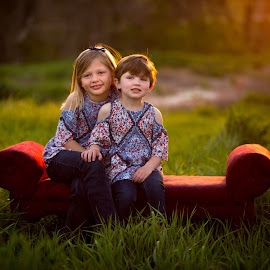 Sisters Forever by Cory Loomis - Babies & Children Child Portraits ( field, girls, sisters, couch, nature, sunset, outdoor, portrait )