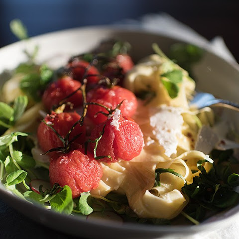 Lemony Ricotta Salata Pasta with Blistered Cherry Tomatoes and Pea Shoots