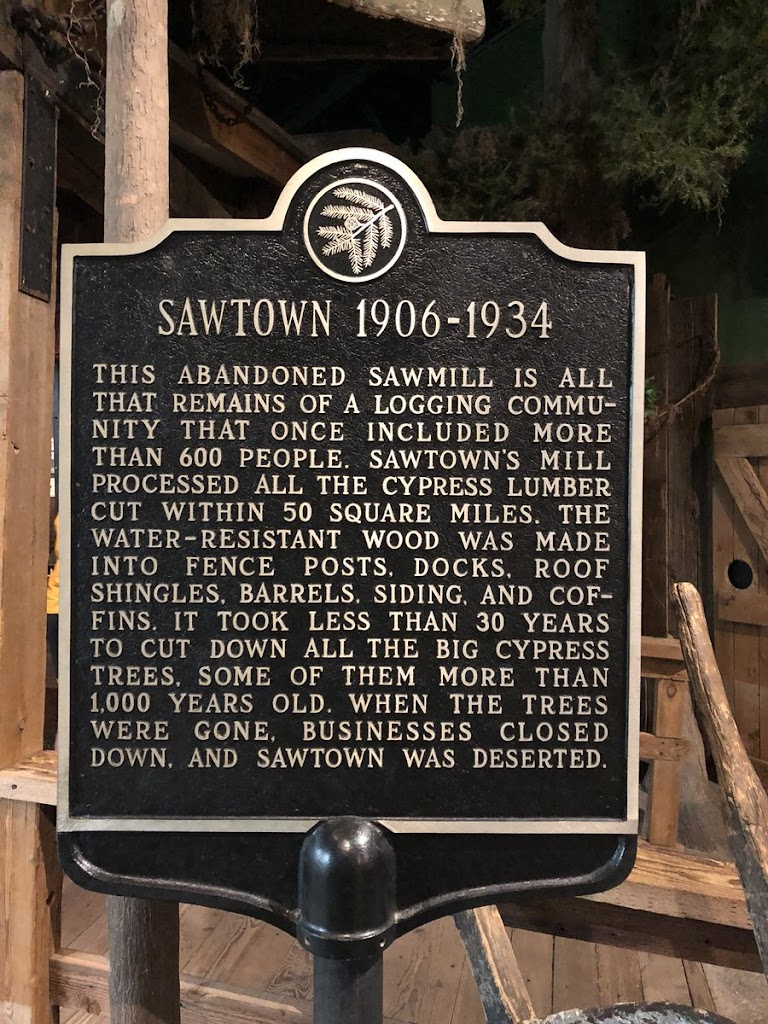 SAWTOWN 1906-1934  THIS ABANDONED SAWMILL IS ALL  THAT REMAINS OF A LOGGING COMMU-  NITY THAT ONCE INCLUDED MORE  THAN 600 PEOPLE. SAWTOWN'S MILL  PROCESSED ALL THE CYPRESS LUMBER  CUT WITHIN 50 ...