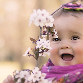 Meeting the Spring for the first time by Antonina Valcheva - Babies & Children Toddlers ( child, brown eyes, natural light, toddler, smile, spring, softness, portrait, eyes )
