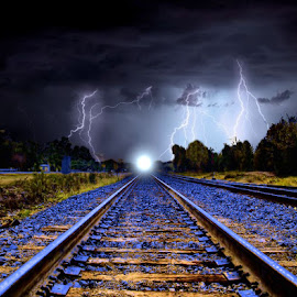 Right down the Middle by Leslie Collins - Digital Art Places ( lightning, sky, night, tracks, landscape, place, digital photography, middle )
