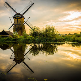 by Kevin Warrilow - Buildings & Architecture Public & Historical ( water, canals, sunset, kinderdijk, holland, reflections, windmills )