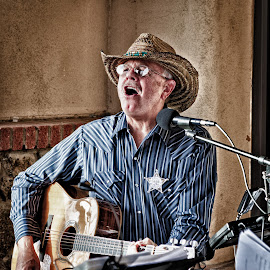 Member of Like Minds by Dave Lipchen - People Musicians & Entertainers ( cowboy, microphone, singing, guitar, badge )
