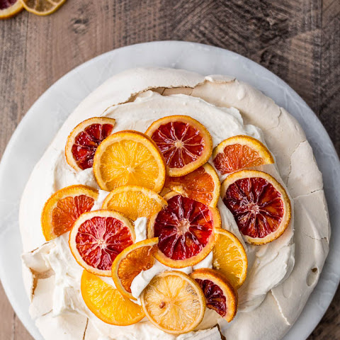 Pavlova with Mascarpone Coconut Cream and Candied Citrus (Gluten-Free)