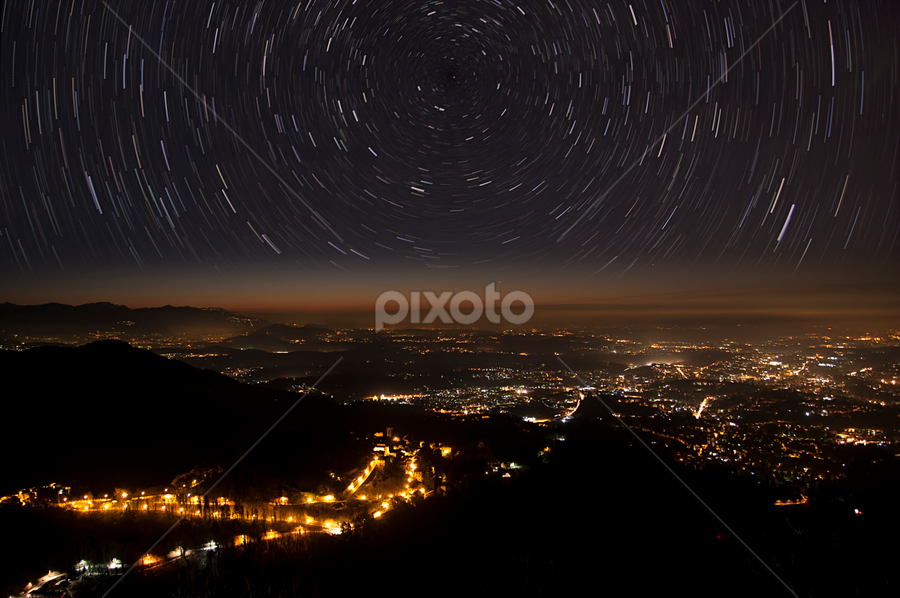 stars trails and city by Massimo De Candido - Landscapes Starscapes ( isolated, nebula, atmosphere, landscape, telescope, space, universe, astronomy, science, exploration, religion, planet, sky, nature, stars, movement, spin, cosmos, night, trails, galaxy )