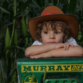 My Big Green Tractor by Chris Cavallo - Babies & Children Child Portraits ( green, corn, curly hair, tractor, cowboy hat, brown eyes, boy,  )