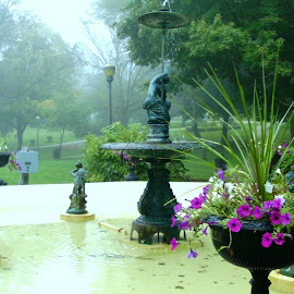 Fountain in Grant Park in Galena by Kathy Rose Willis - City,  Street & Park  City Parks ( galena, foggy, illinois, park, green, fountain, flowers )