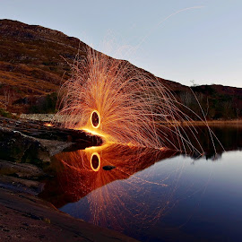Steel wool reflections by Nik Hall - Abstract Light Painting ( reflection, ireland, killarney, steel wool, steelwool, trees, reflections, killarney national park, sparks, rocks )