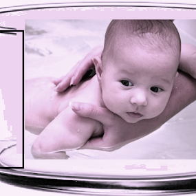 baby getting pleasure in a tumbler by Jayita Mallik - Digital Art People ( baby tumbler, identity, bath, water, lifestyle )