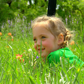 Joyful day. by Anna Cole - Babies & Children Child Portraits ( child, girl, red, nature, grass, green, texas, laying, toddler, flowers, smile, spring, portrait,  )