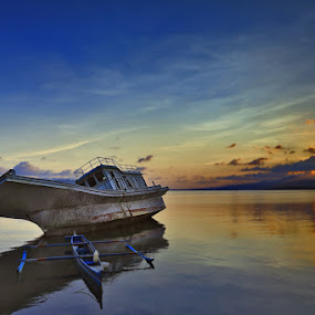 Broken Boat by Rudy Harianto - Landscapes Waterscapes