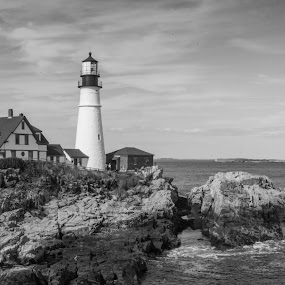 Black and White Headlight by Thomas Shaw - Black & White Buildings & Architecture ( water, clouds, portland, maine, atlantic ocean, black and white, waves, rocky, white, lighthouse, portland headlight, black and white photography, ocean, house, photography, coast, sky, rocky coast, portland maine, light, rocks, black,  )