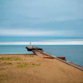 Grand Marais Light by Greg Sell - Landscapes Waterscapes ( sand, grand marais, superior, blue, breakwater, cloud, long exposure, lake, jetty, beach, light, gloomy )