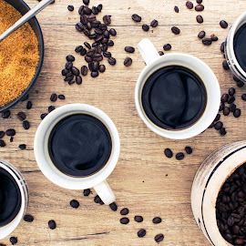 4 Black coffees with beans and sugar on wooden sufrace from abov by Carl Birchenough - Food & Drink Alcohol & Drinks ( cup, aroma, caffeine, aromatic, breakfast, spoon, mug, fresh, beans, drink, dark, above, roasted, objects, black, closeup, top, isolated, bean, espresso, texture, coffee, white, morning, close-up, tasty, liquid, beverage, 4, background, cafe, hot, brown, view, sugar )