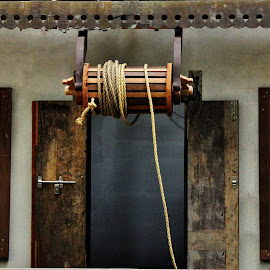 The well in a home! by Anoop Namboothiri - Buildings & Architecture Homes ( woode, water, home, wood work, rope, bucket, artistic, door, wooden window, drum, architecture, well, antique,  )