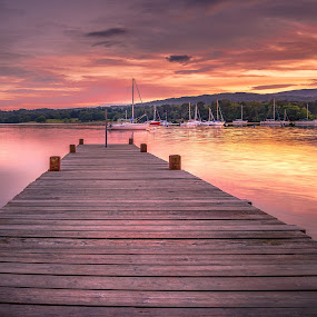Sunset at Ambleside by Darrell Evans - Landscapes Waterscapes ( water, countryside, clouds, hills, uk, lake, boat, landscape, lake district, ambleside, mountains, sky, windermere, sunset, outdoor, trees, pier )