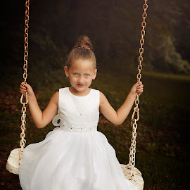 Flower Girl on a Swing by Joseph Humphries - Babies & Children Child Portraits ( beautiful, precious, blue eyes, white dress, smile, swing, flower girl )