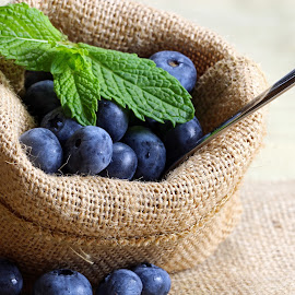 Blueberries ina burlap bag by Dipali S - Food & Drink Fruits & Vegetables ( plant, juicy, concept, blueberry, mint leaves, leaves, crop, super food, bilberry, nature, fresh, antioxidant, vegetarian, closeup, bowl, fruit, green, health, nutrition, organic, wooden, blue, food, background, ripe, healthy, summer, eating, vitamin, natural )