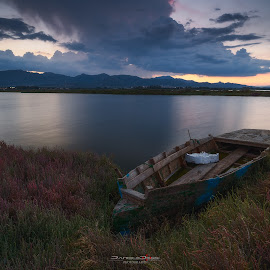 rainy sunset by Daniele Dessì - Transportation Boats ( sunset, boat, landscape, italy, rain )
