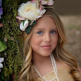 Golden by Carole Brown - Babies & Children Child Portraits ( little girl, blonde hair, pearls, floral swing, blue eyes )
