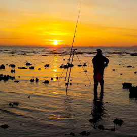 Beach Fishing on the Solway Coast at Sunset by David Lomax - Sports & Fitness Other Sports ( cumbria, sunset, coastline, fisherman, solway, allonby, southern scotland )