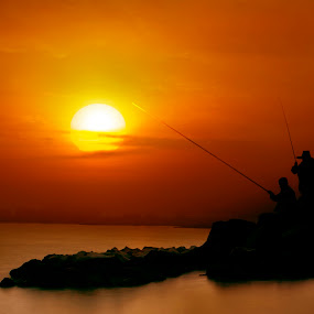 Fishing by Mohamad Sa'at Haji Mokim - Digital Art Places ( sunset, digital art, stone, sea, place )