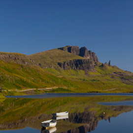 Boats at anchor by Gordon Bain - Landscapes Waterscapes ( calm, trotternish ridge, reflection, skye, boats )