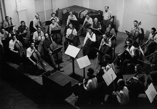 Matz here rehearses with a cello orchestra for television in 1950.
