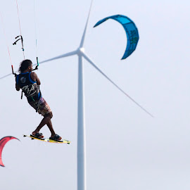 kitesurfing is about flying by Dan Baciu - Sports & Fitness Watersports ( slingshot, extreme sports, kitesurfing, kitesurf, kiteboard, edventure sports, north, windsurf, island, watersport, flying, adventure, adventure sport, sailing, parasailing, kites, extreme sport, wind, extreme, kite, sea, kiteboarding, windsurfing, fly, kiting, land kiting, windmill )