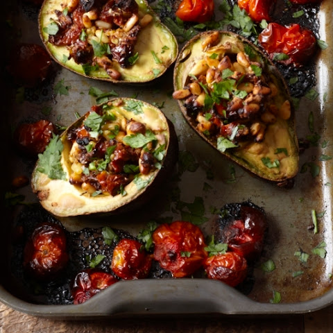 Deliciously Ella's baked avocado with sun-dried tomatoes and pine nuts