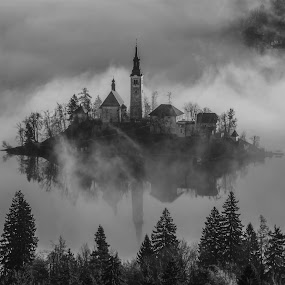 Church on the Island in Mist Sunrise by Aleš Krivec - Black & White Buildings & Architecture ( water, reflection, church, beautiful, white, lake, sacred, reflecting, island, foggy, mountains, winter, tree, window, slovenia, bled, castle, misty, mist )