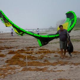 Heading Home by Sandy Friedkin - Sports & Fitness Watersports ( fog, following a hurricane, wind surfer, kite, ocean, beach, man,  )