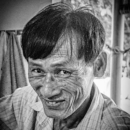 The Barber by Richard Michael Lingo - People Portraits of Men ( portraits, vietnam, barber, man, people )