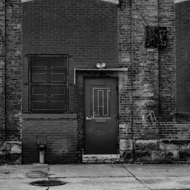 whats behind the door by Tim Hauser - City,  Street & Park  Street Scenes ( urban photography, art photography, tim hauser photography, black and white photography, street photography )