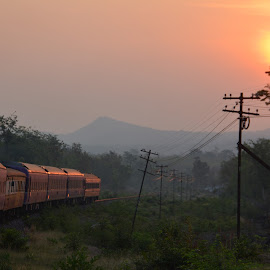 long train by Dean Moriarty - Transportation Railway Tracks ( dawn, railroad, train, sunrise, tracks )