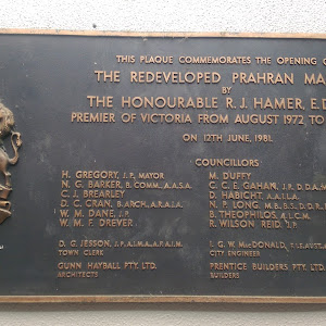 The plaque is located inside the market on the rear of  a column in the outdoor courtyard. It has the City of Prahran coat of arms. Plaque reads: THIS PLAQUE COMMEMORATES THE OPENING OF THE ...
