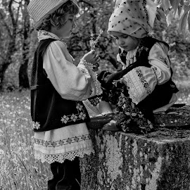 age of innocence by Marius Barbos - Babies & Children Child Portraits ( traditional costume, black and white, innocence, children, childhood, summertime, flowers )